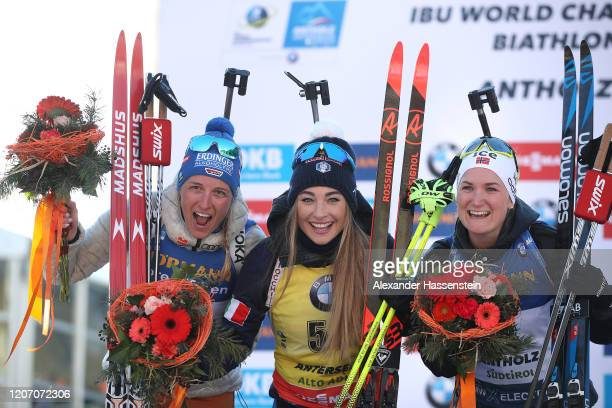 Vanessa Hinz of Germany Dorothea Wierer of Italy and Marte Olsbu Roeiseland of Norway celebrate after the Women 15 km Individual Competition at the...