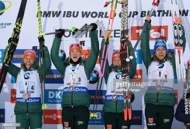 Vanessa Hinz of Germany, Franziska Hildebrand of Germany, Maren Hammerschmidt of Germany and Laura Dahlmeier of Germany celebrate on the podium for...