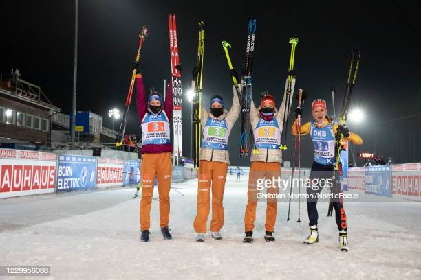 Vanessa Hinz of Germany, Franziska Preuss of Germany, Maren Hammerschmidt of Germany, Denise Herrmann of Germany celebrate during the Women 4x6 km...