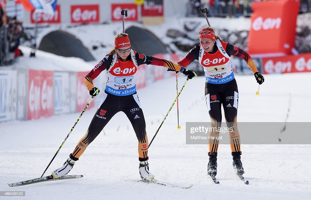 Vanessa Hinz (R) of Germany makes the final change-over to Franziska Preuss (L) of Germany during the women 4 x 6 km relay event in the IBU Biathlon World Cup on December 13, 2014 in Hochfilzen, Austria.