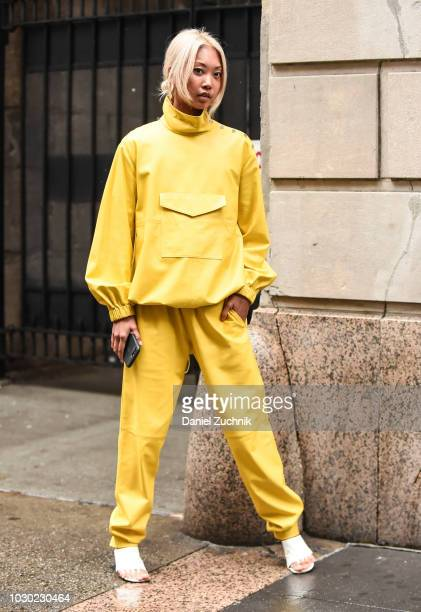 Vanessa Hong is seen wearing a yellow Tibi top and pants with Celine shoes outside the Tibi show during New York Fashion Week Women's S/S 2019 on...