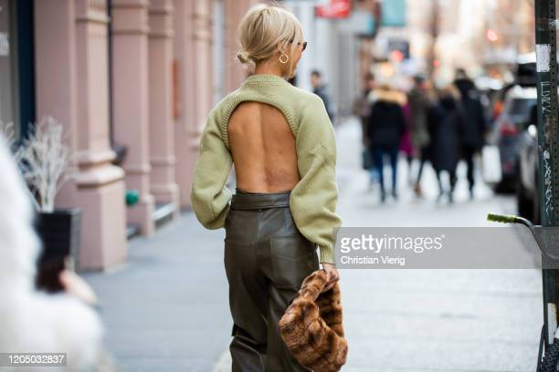Vanessa Hong is seen wearing knit, olive pants, brown faux fur bag outside Tibi during New York Fashion Week Fall/Winter 20 on February 08, 2020 in...