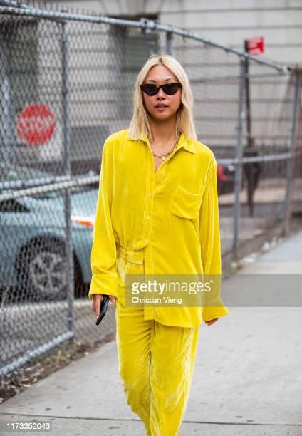 Vanessa Hong is seen wearing yellow velvet button shirt and pants outside Sies Marjan during New York Fashion Week September 2019 on September 08...