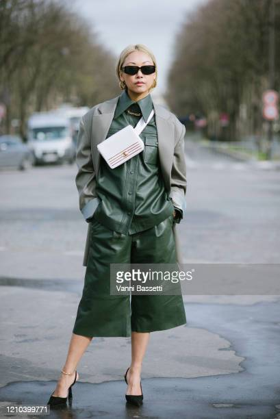Vanessa Hong poses with a Chanel bag after the Chanel show at the Grand Palais during Paris Fashion Week Womenswear Fall/Winter 2020/2021 on March...