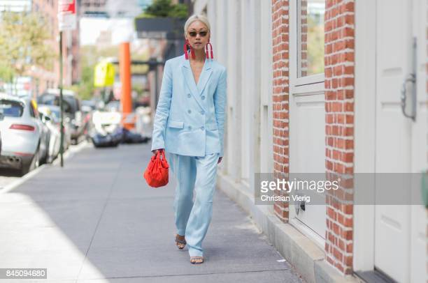 Vanessa Hong wearing a blue suit red earings seen in the streets of Manhattan outside Tibi during New York Fashion Week on September 9 2017 in New...