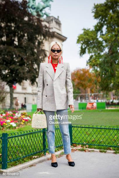 Vanessa Hong wearing a checked blazer is seen before the Maison Margiela show at the Grand Palais during paris Fashion week Womenswear SS18 on...