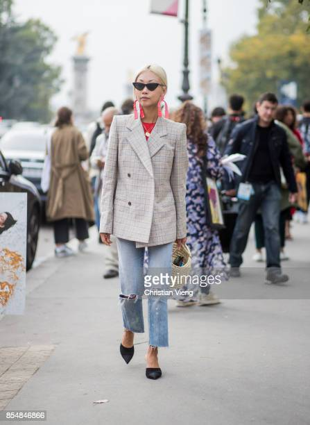 Vanessa Hong wearing a checked blazer is seen outside Maison Margiela during Paris Fashion Week Spring/Summer 2018 on September 27 2017 in Paris...