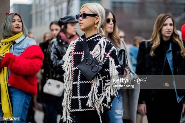Vanessa Hong wearing belt bag sunglasses seen outside SelfPortrait on February 10 2018 in New York City