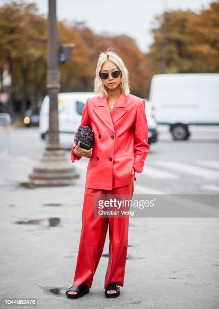 Vanessa Hong wearing red leather suit is seen outside Chanel during Paris Fashion Week Womenswear Spring/Summer 2019 on October 2 2018 in Paris France