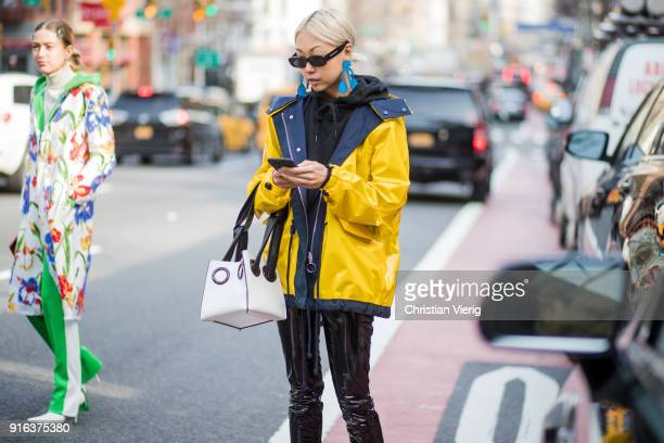 Vanessa Hong wearing yellow jacket bag vinyl pants slingbacks seen outside Tory Burch on February 9 2018 in New York City