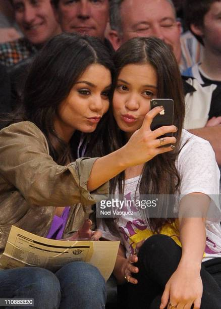 Vanessa Hudgens and and her sister Stella Hudgens attend a game between the Phoenix Suns and the Los Angeles Lakers at Staples Center on March 22...