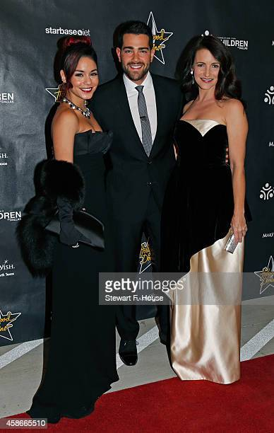 Vanessa Hudgens Jesse Metcalf and Kristin Davis attend the Hollywood Domino Dallas charity event at The Empire Room on November 8 2014 in Dallas Texas
