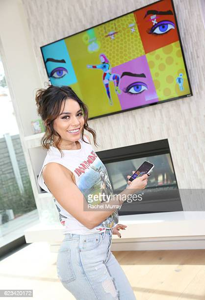 Vanessa Hudgens plays Just Dance 2017 using the Just Dance Controller App to score her moves during her Friendsgiving on November 15 2016 in Los...