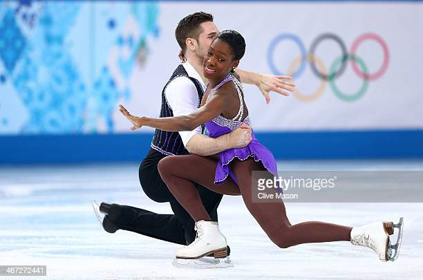 Vanessa James and Morgan Cipres of France compete in the Figure Skating Pairs Short Program during the Sochi 2014 Winter Olympics at Iceberg Skating...
