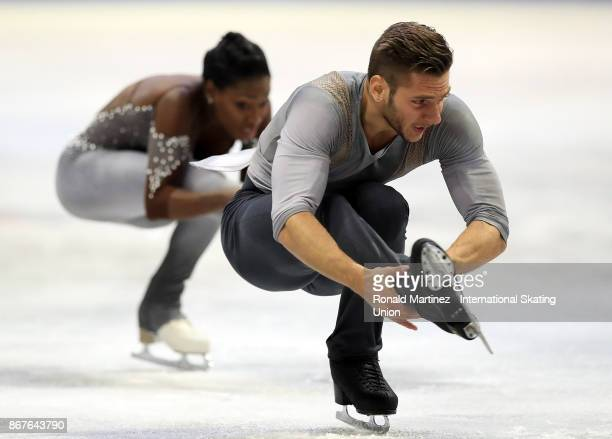 Vanessa James and Morgan Cipres of France perform in pairs free skating during the ISU Grand Prix of Figure Skating at Brandt Centre on October 28...