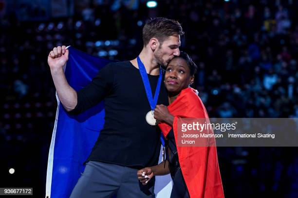 Vanessa James and Morgan Cipres of France react in the Pairs medal ceremony during day two of the World Figure Skating Championships at Mediolanum...