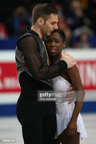 Vanessa James is comforted by partner Morgan Cipres of France after she was dropped on the ice in the Pairs Free Program during ISU World Figure...