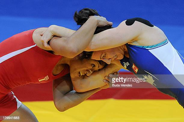 Vanessa Jenny Mallqui of Peru, fights against Lynn Verbeek of Canad a, in the Women's Freestyle 55 kg during the Pan American Games Guadalajara 2011...