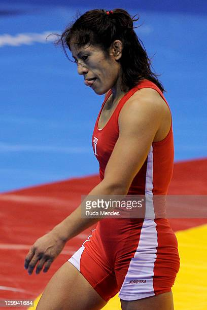 Vanessa Jenny Mallqui of Peru fights against Lynn Verbeek of Canad a in the Women's Freestyle 55 kg during the Pan American Games Guadalajara 2011 at...