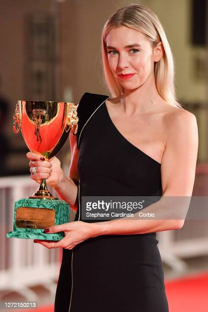 Vanessa Kirby poses with the Coppa Volpi for Best Actress during the winners photocall at the 77th Venice Film Festival on September 12, 2020 in...