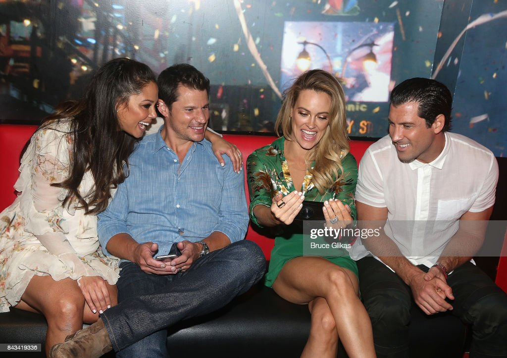 Vanessa Lachey, Nick Lachey, Peta Murgatroyd and Maks Chmerkovskiy facetime their baby Shai at ABC's 'Dancing with the Stars' Season 5 cast announcement event at Planet Hollywood Times Square on September 6, 2017 in New York City.
