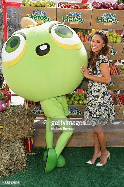 Vanessa Lachey poses with Farm Heroes Sage 'Cropsies' as they honor the launch of new mobile game Farm Heroes Saga with an ode to urban farming at a...