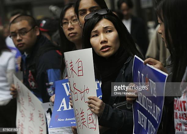 Vanessa Leung with the Coalition for AsianAmerican Children and Families looks left during an sidewalk rally against proposed crackdowns on illegal...