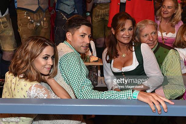 Vanessa Mai Andreas Ferber Andrea Berg and Uli Ferber during the opening of the 2016 Oktoberfest beer festival in the Schottenhamel tent at...