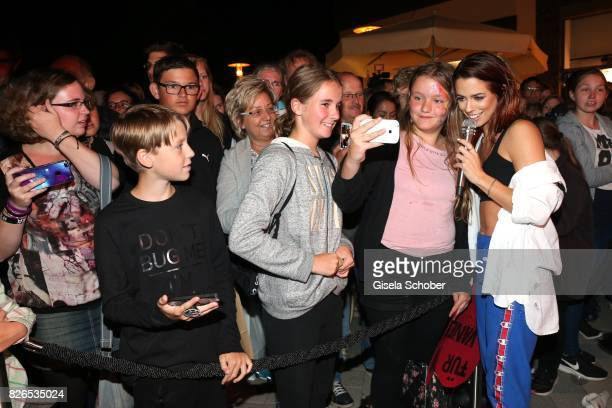 Vanessa Mai takes a selfie with fans during the late night shopping at Designer Outlet Soltau on August 4 2017 in Soltau Germany