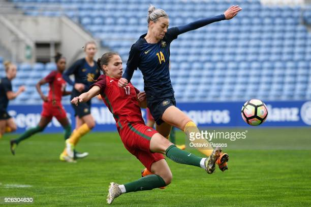 Vanessa Marques of Portugal competes for the ball with Alanna Kennedy of Australia during the Women's Algarve Cup Tournament match between Portugal...