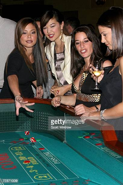 Vanessa Minillo and SuChin Pak play craps at The Hassenfeld Committee's Adults in Toyland Casino Night Gala presented by Harrah's Entertainment at...
