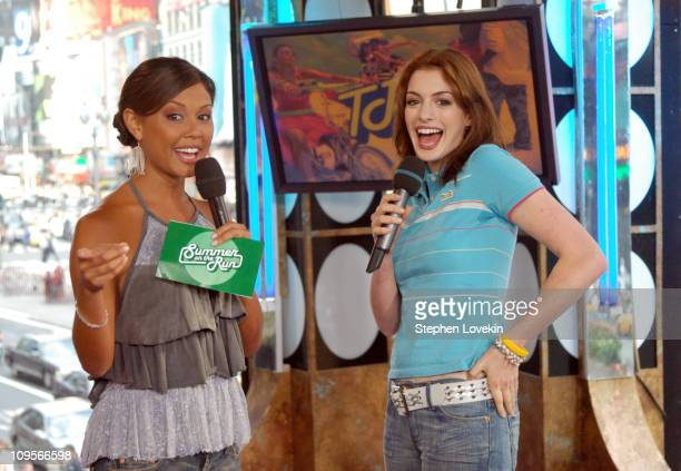 Vanessa Minnillo and Anne Hathaway during Anne Hathaway and Jet Li Visit MTV's 'TRL' August 10 2004 at MTV Studios in New York City New York United...