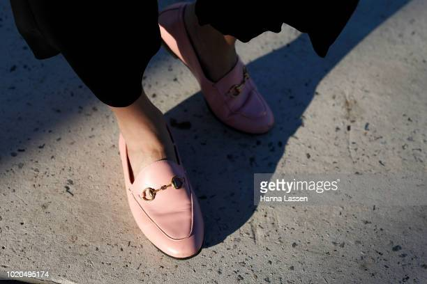 Vanessa Moe shoe detail wearing a Vanessa Moe fringe jacket and black cropped pants pink Gucci loafers and vintage earrings on August 21 2018 in...