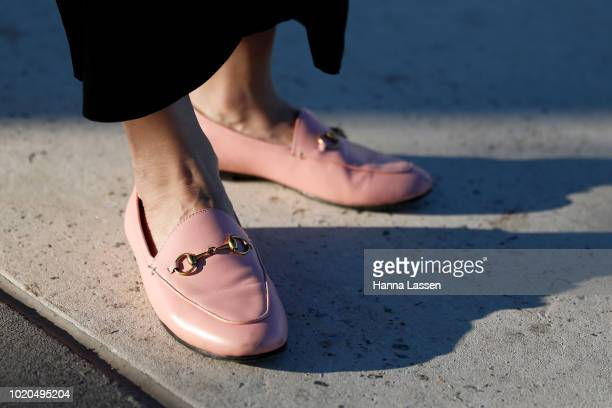 Vanessa Moe, shoe detail, wearing a Vanessa Moe fringe jacket and black cropped pants, pink Gucci loafers and vintage earrings on August 21, 2018 in...