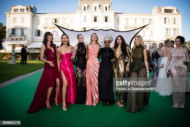 Vanessa Moody Georgia Fowler Hannah Ferguson Megan Williams Halima Alden Shanina Shaik and Nadine Leopold pose for portraits at the amfAR Gala Cannes...