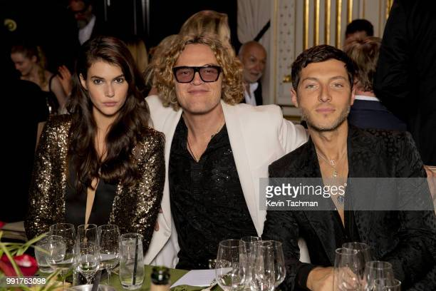 Vanessa Moody Peter Dundas and Evangelo Bousis attend the amfAR Paris Dinner at The Peninsula Hotel on July 4 2018 in Paris France