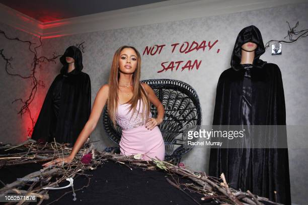 Vanessa Morgan attends Netflix Original Series Chilling Adventures of Sabrina red carpet and premiere event on October 19 2018 in Los Angeles...