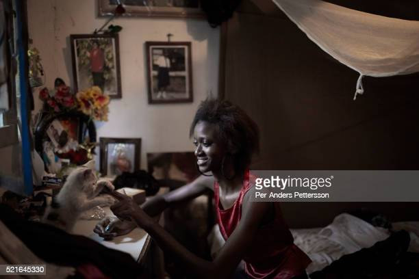 Vanessa Nsul Kilem age 21 does her nails in her home in Petro Congo district of Kinshasa on July 17 2014 She dreams of becoming a super model She has...