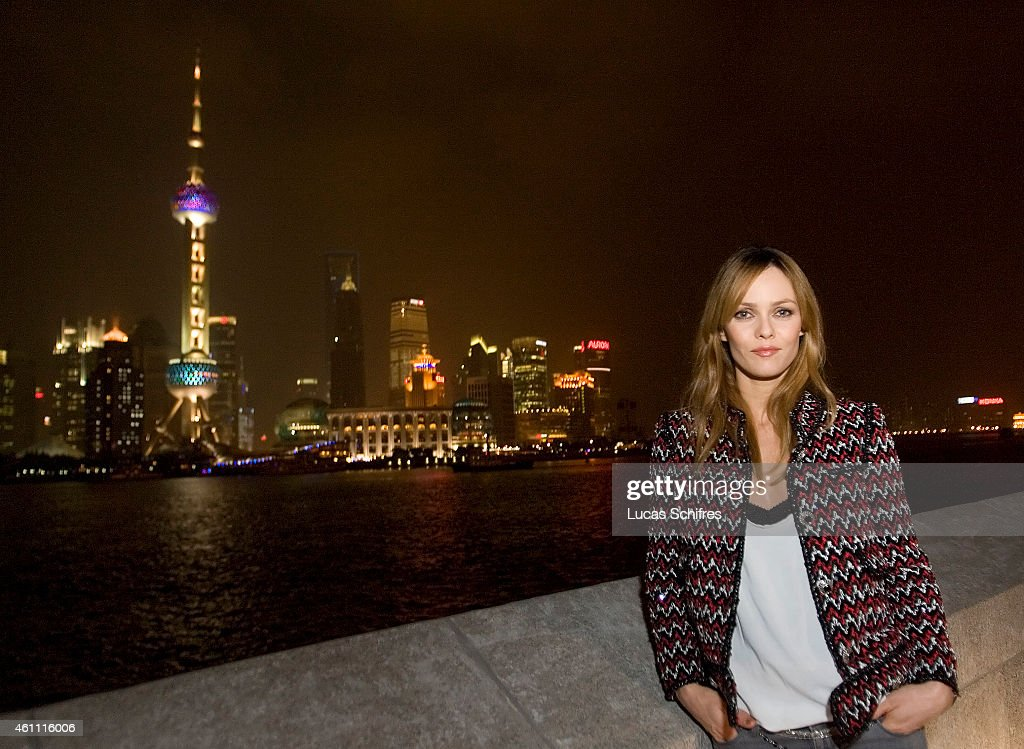 Vanessa Paradis poses for a photograph in front of the Oriental TV Tower and the Pudong skyline, considered the symbol of Shanghai at Chanel Fashion Show on December 3, 2009 in Shanghai, China.