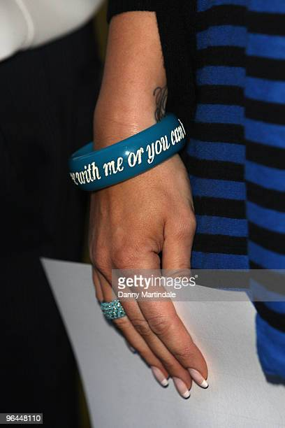 Vanessa Perroncel's bracelet detail is seen as she attends a press conference regarding recent allegations of an affair with John Terry on February 5...