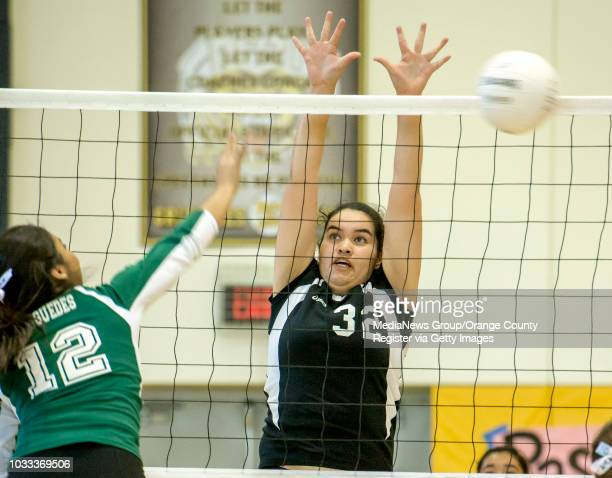 Vanessa Praguedes of Saddleback left goes up against Alyssa Lopez of Godinez in a girls volleyball game at Godinez High School ///ADDITIONAL...