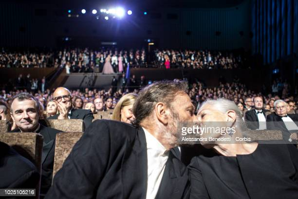 Vanessa Redgrave is kissed by Franco Nero after having received the Golden Lion for Lifetime Achievement Award during the opening ceremony and the...
