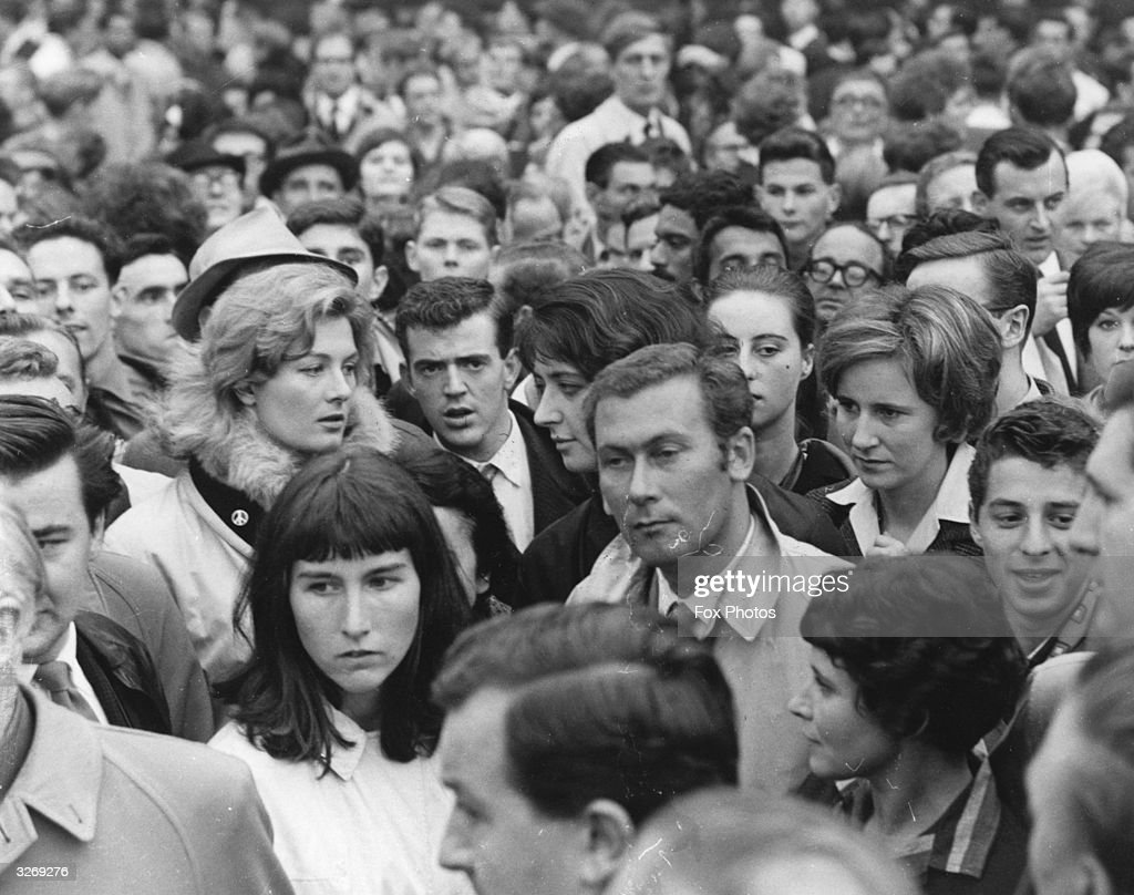 Vanessa Redgrave, Shelagh Delaney and John Osborne (1929 - 1994) amongst the crowd in Trafalgar Square in London for a sit-down anti-nuclear demonstration organised by the Committee of 100.