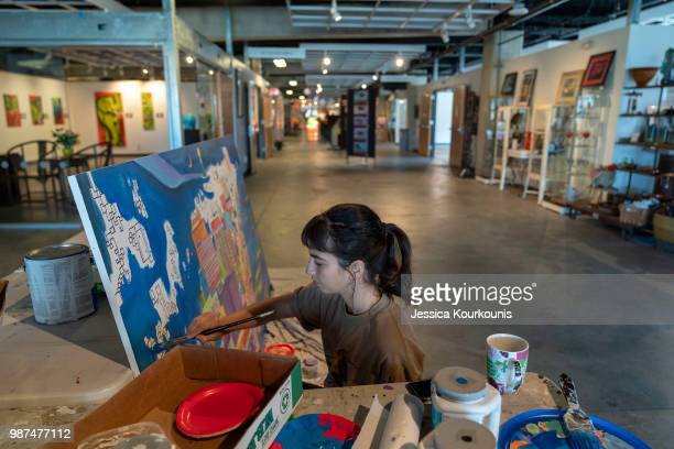 Vanessa Spotten works on a painting inside the Arts Garage of Stockton University in the new Arts District on June 29 2018 in Atlantic City New...