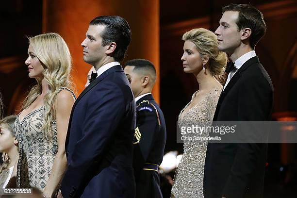 Vanessa Trump and her husband Donald Trump Jr and Ivanka Trump and her husband Jared Kushner watch US President Donald Trump cut a cake during the...