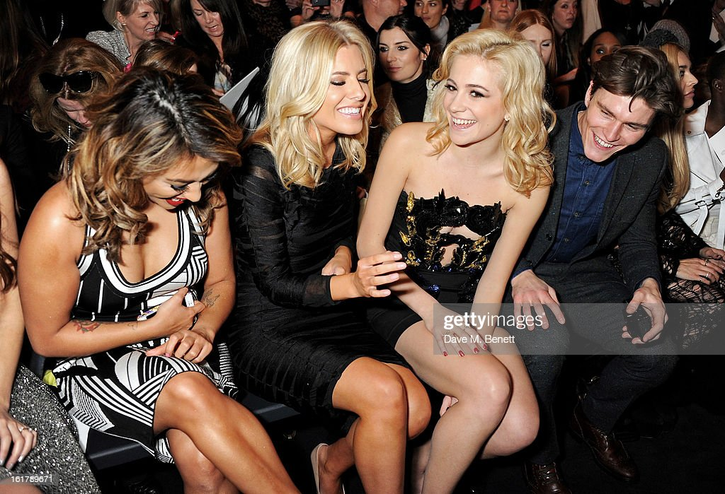Vanessa White, Mollie King, Pixie Lott and Oliver Cheshire attend the Julien Macdonald show during London Fashion Week Fall/Winter 2013/14 at Goldsmiths' Hall on February 16, 2013 in London, England.