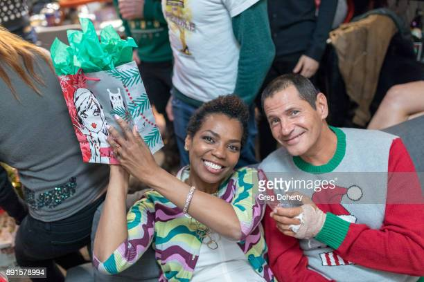 Vanessa Williams and Thomas Collabro display their Secret Santa Gifts at The Bay Ugly Sweater And Secret Santa Christmas Party at Private Residence...