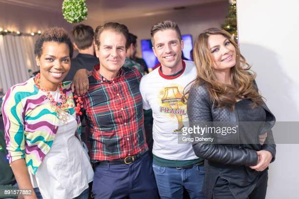 Vanessa Williams Vincent de Paul Scott Bailey and Lilly Melgar attend The Bay Ugly Sweater And Secret Santa Christmas Party at Private Residence on...