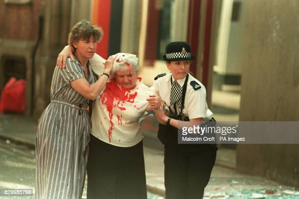 PC Vanessa Winstanley from Wigan and another woman help an elderly injured woman away from Manchester city centre after an IRA bomb exploded in the...