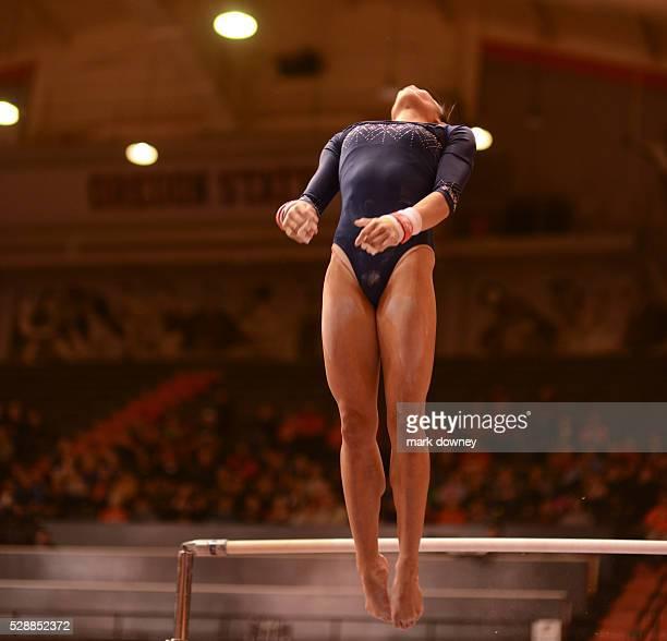 Vanessa Zamarripa of UCLA dismounts on the uneven Bars
